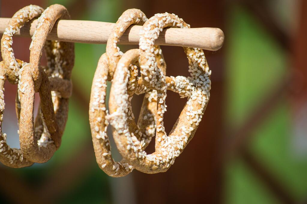 pretzels hanging on a wooden pole