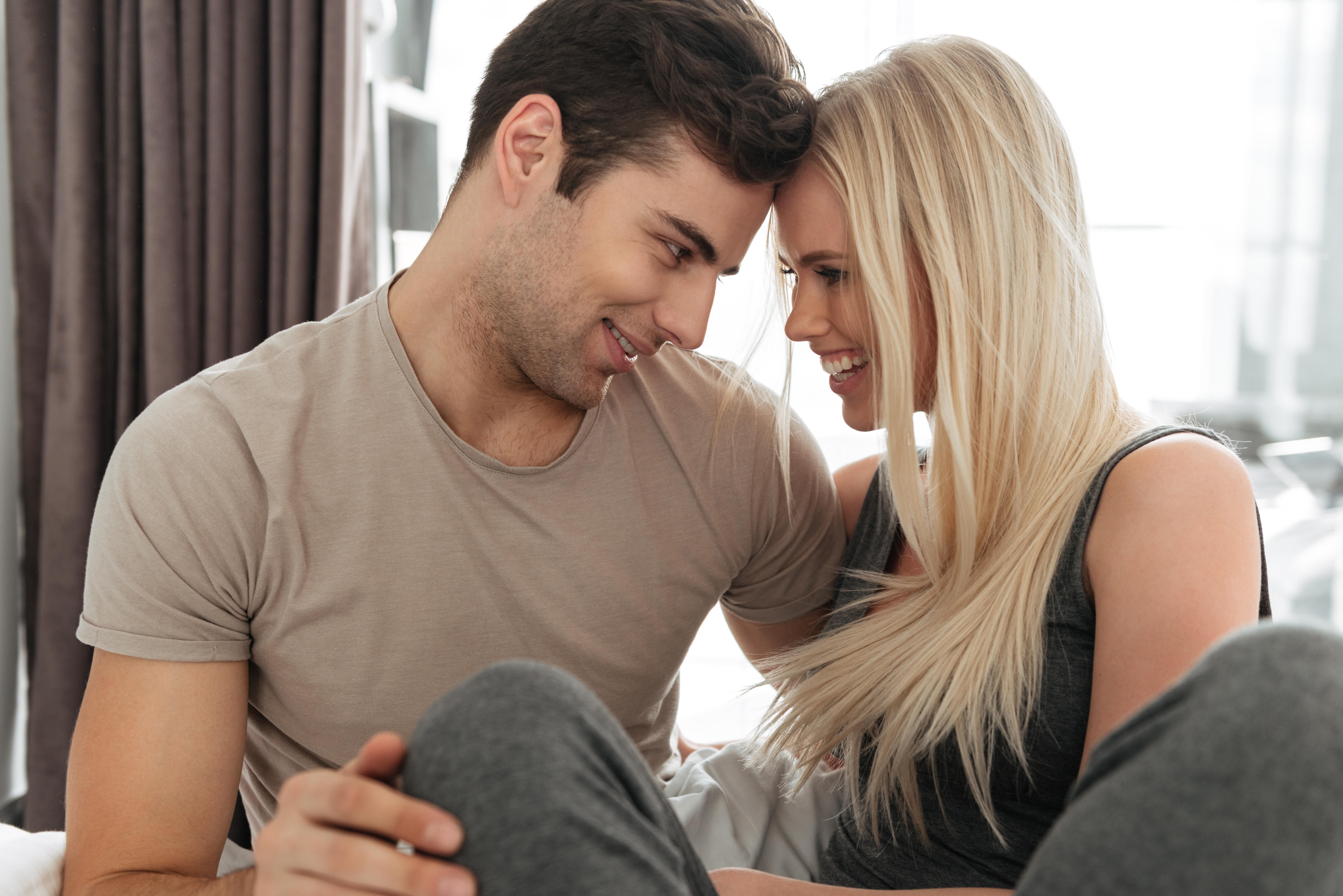 romance_man_woman_face_2_face_bed_shutterstock_769634806