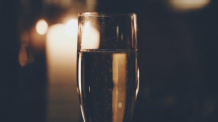 Champagne_glass_candles_ben-wilkins-607039-unsplash