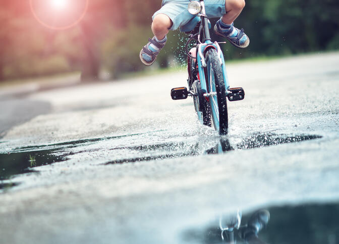 Lower_half_Child_Biking_puddles_ss_448938907