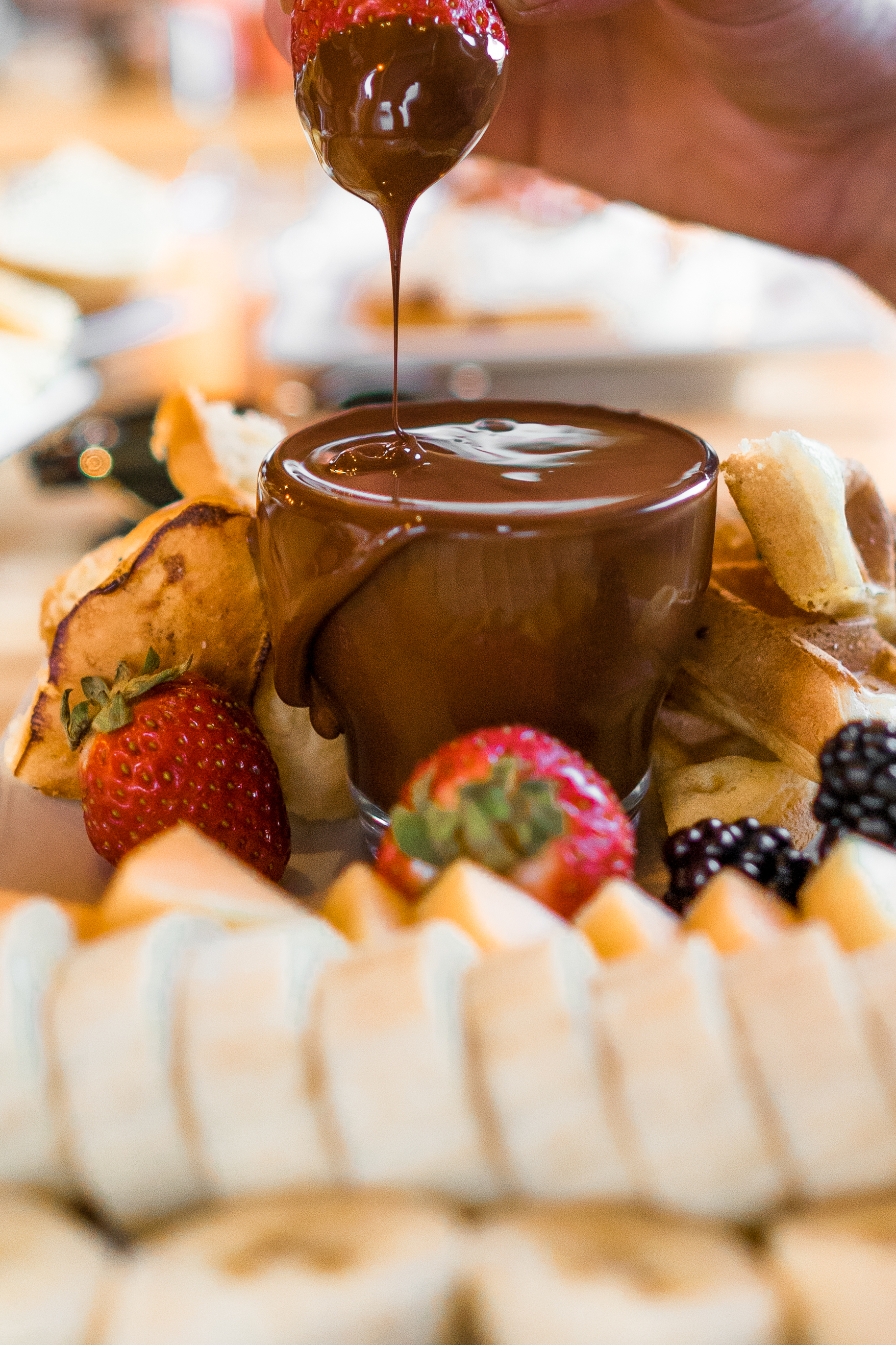 Monki_Dark_Chocolate_Fondue_served_with_waffles_and_fruit