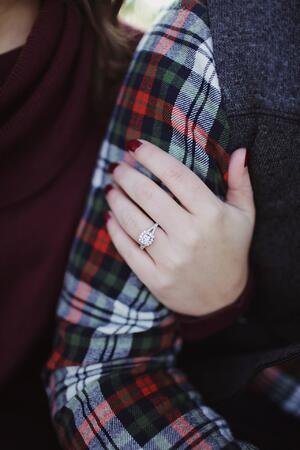 arm-couple-engagement-ring