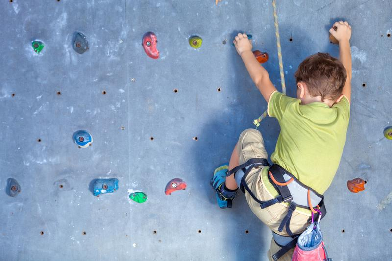 child-kid-climbing-rock-wall