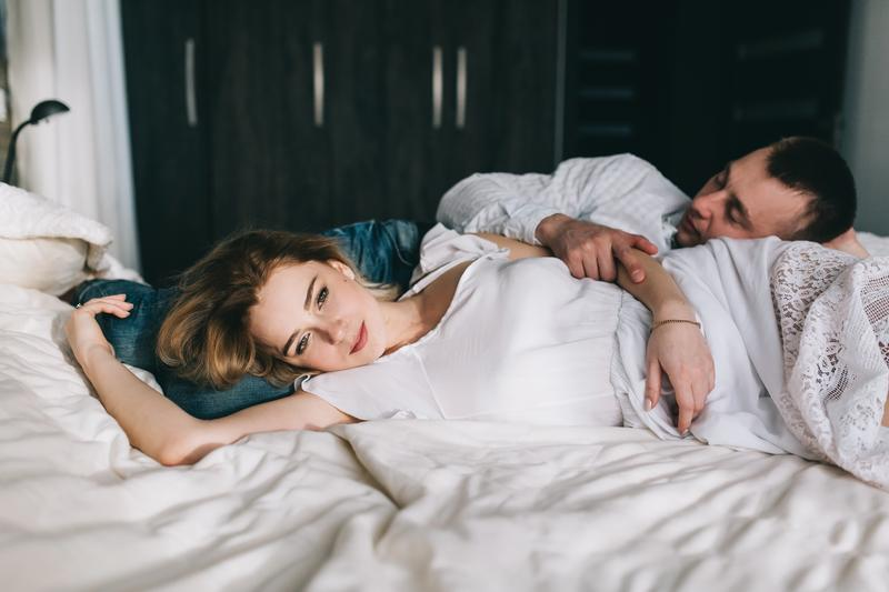 couple-laying-bed-shutterstock_599967518