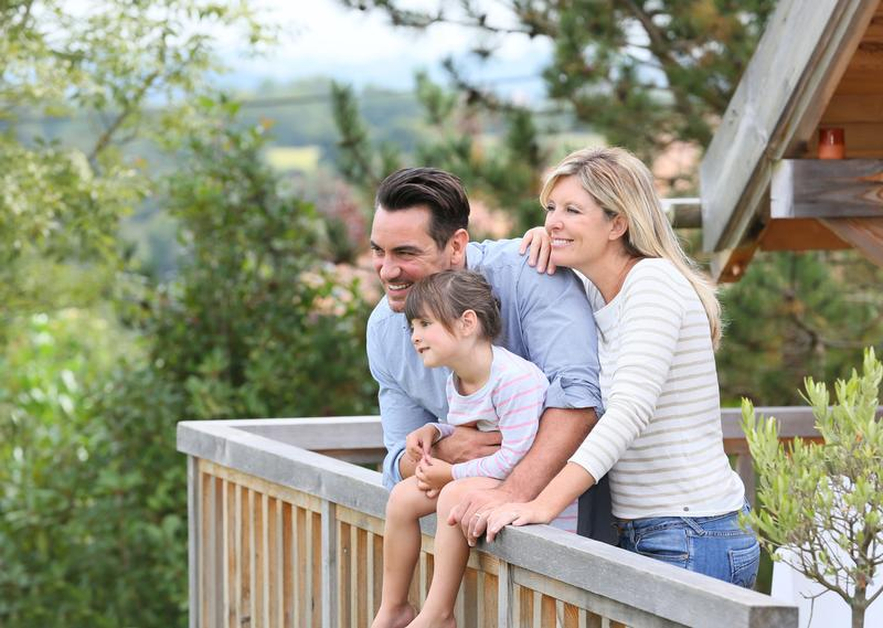family-cabin-outdoors-shutterstock_219080173
