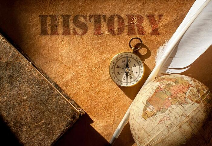 history-compass-map-feather-shutterstock_137910917