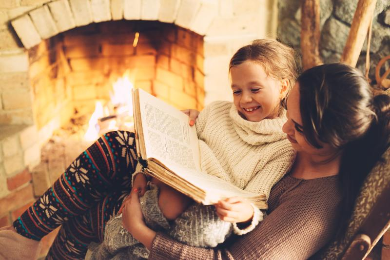 mother-daughter-fireplace-shutterstock_481436944