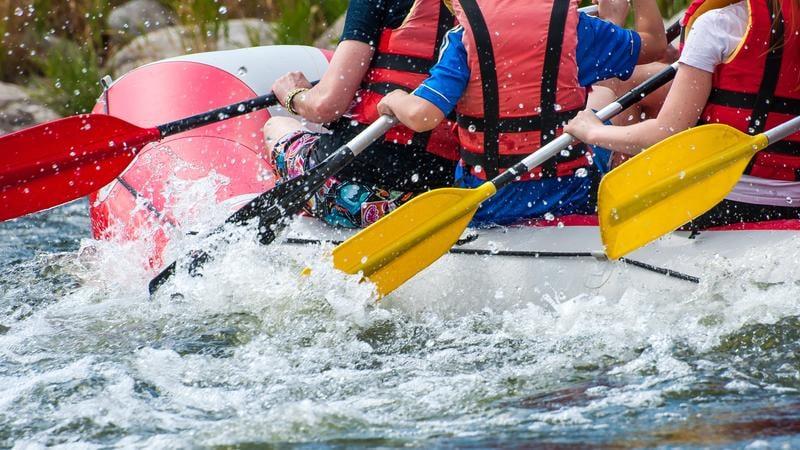 river-rafting-shutterstock_674508856